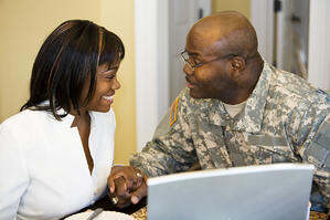 iStock_000005828321Medium_military_couple_at_computer_(2)